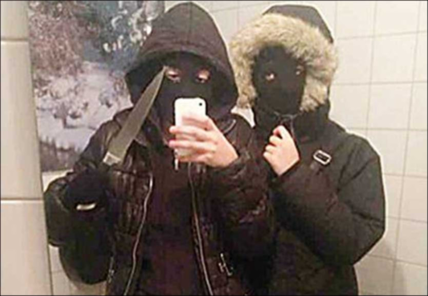 """Two girls in Sweden took this photo on a smartphone before robbing a restaurant. Technically, this is also """"ICT literacy""""."""